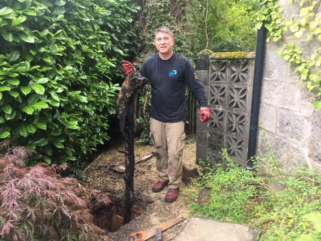 Gary, one of our Drainage Engineers fixing a blocked drain